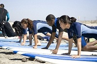 Nike group surf lessons push up postion on surfboard